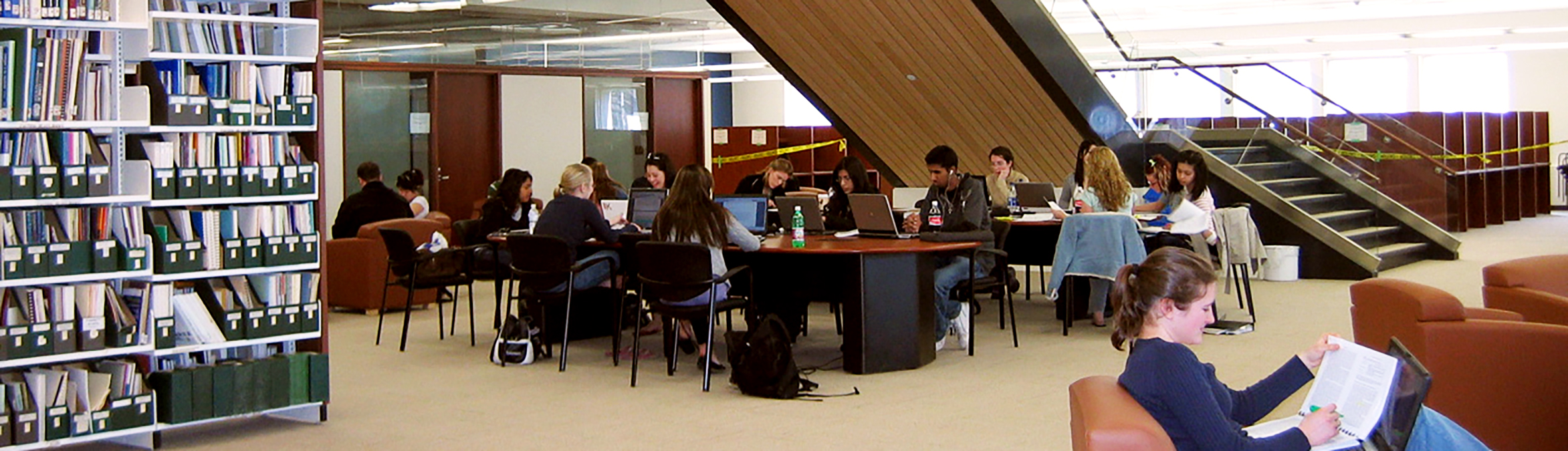 Students studying and working under the stairs of the Health Sciences Library