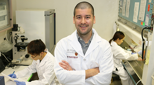 Jeremy Hirota and his students in a lab