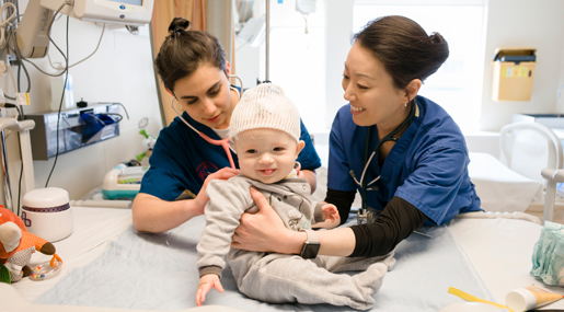 Two Nursing students examining a child patient