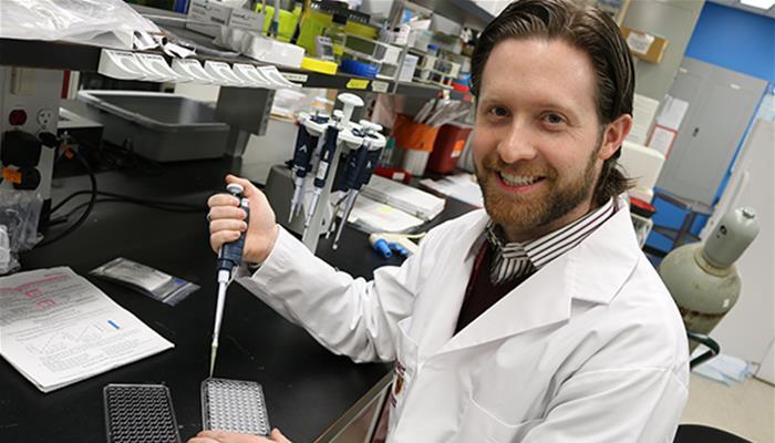 Matthew Millar in his lab