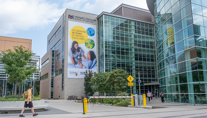 A billboard celebrating 50 years of excellence for the McMaster Medical School.
