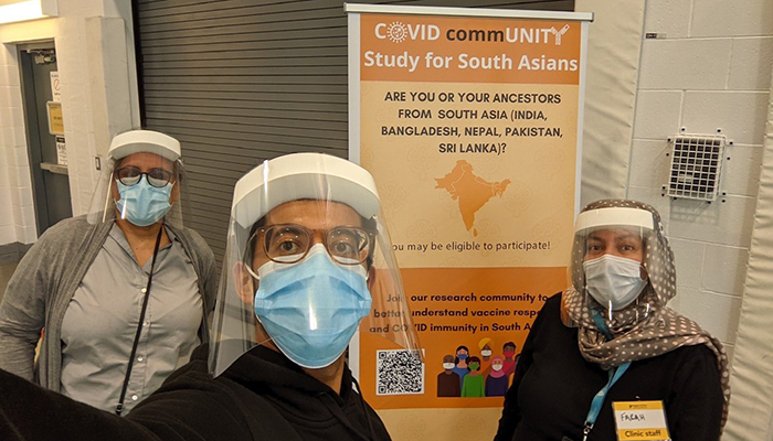 Research assistants Dipika Desai, Jayneel Limbachia and Farah Khan (left to right) at a vaccine clinic in Brampton, Ontario. Credit: Jayneel Limbachia
