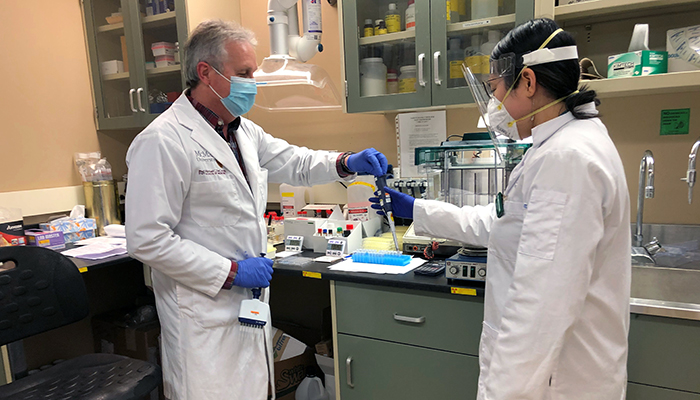 James Smith and Angela Huynh working in the McMaster Platelet Immunology Laboratory