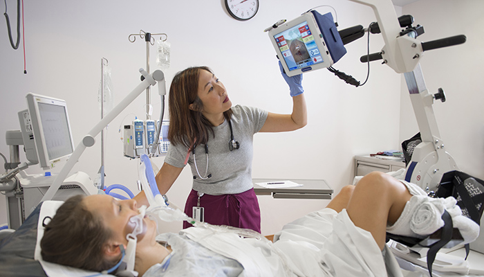 Dr. Michelle Kho with an ICU patient