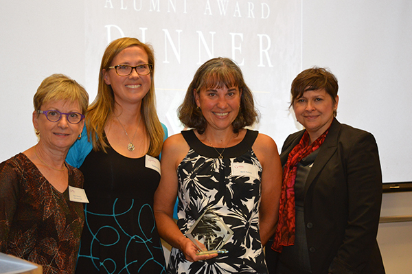 Patty Solomon, associate dean and director of rehabilitation science, left, Tania Brittain and Barb Pollock, centre, accepting on behalf of Carmen Kirkness-Asche, and Vanina Dal Bello-Haas, assistant dean of physiotherapy.