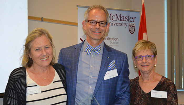 Julie Richardson, assistant dean of rehabilitation science, left, recipient Greg Spadoni, centre, and Patty Solomon, associate dean and director of rehabilitation science.