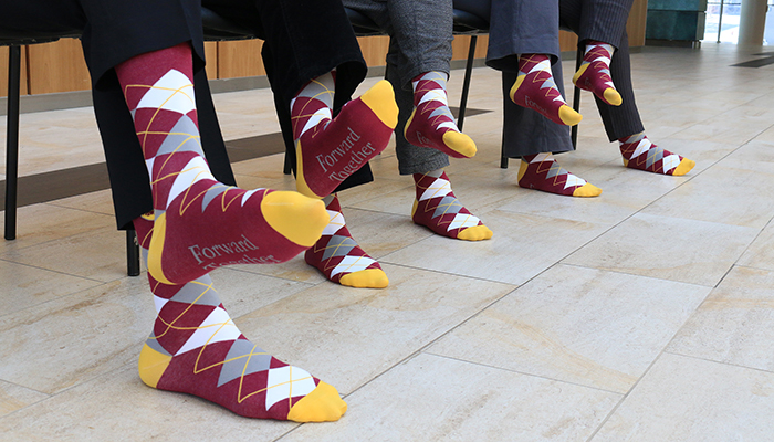A close-up look at Shadd socks modeled by members of the Department of Family Medicine at McMaster.