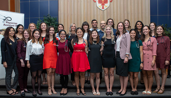 25 new physician assistant (PA) students who were welcomed into the profession at McMaster's first stethoscope ceremony Sept. 13.