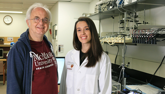 Jan Huizinga, director and academic advisor of the BioPharm program, and Alicia Hanman, a fifth-year student in the program at McMaster University. Photo by Tina Depko