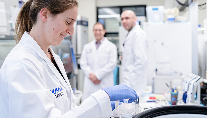 Danielle Hayes, researcher in engineering and process development with Triumvira Immunologics Inc., prepares a vessel containing engineered cells for a high-speed spin.