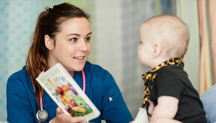 A McMaster University nursing student connects with a young patient.