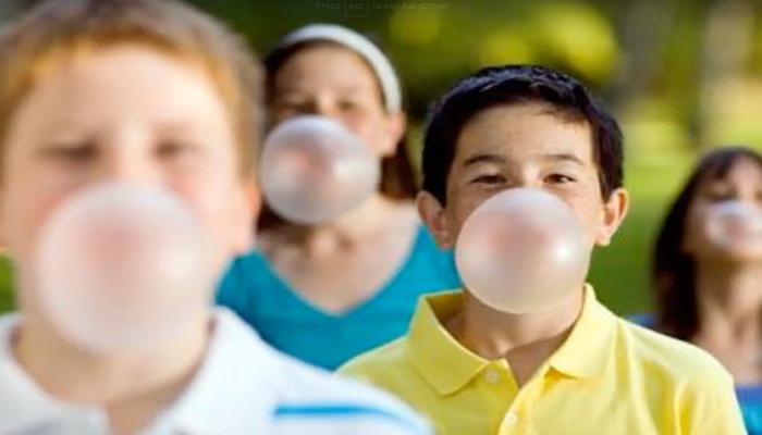 Children blowing bubble gum