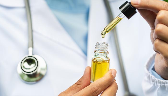 Doctor holding a medical marijuana product
