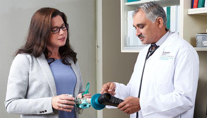 Dr. Parameswaran Nair (right) in the Sputum Lab at St. Joe's